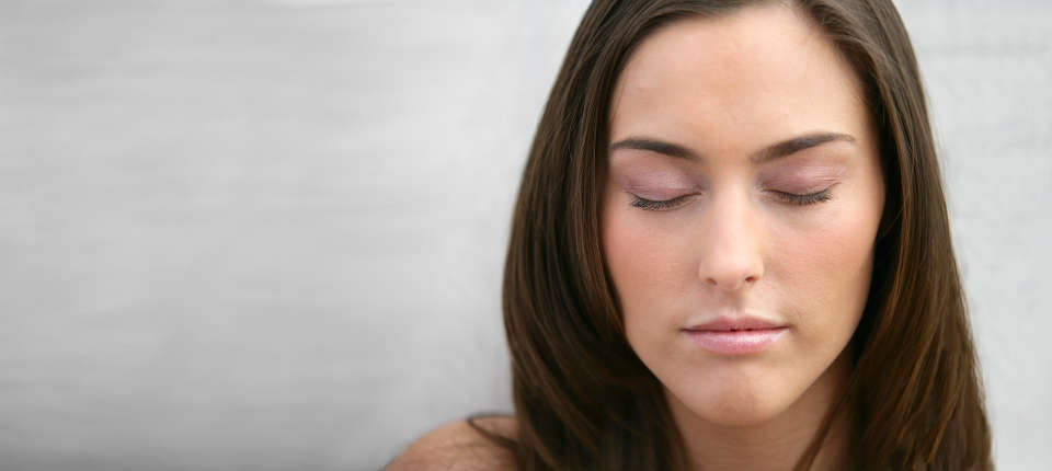 Woman Meditating Eyes Closed